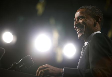 U.S.President Barack Obama smiles as he talks about the economy at the SUNY-Albany Nano-Fab Extension Building in Albany, New York May 8, 2012. REUTERS/Larry Downing