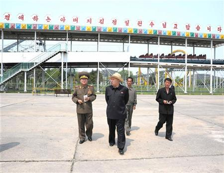 North Korean leader Kim Jong-Un (C, front) visits the Mangyongdae Funfair in this undated picture released by the North's KCNA news agency in Pyongyang May 9, 2012. REUTERS/KCNA