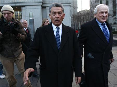 Rajat Gupta, (C) a former director of Goldman Sachs Group Inc., exits Manhattan Federal Court in New York with his lawyers, February 7, 2012. REUTERS/Brendan McDermid/Files