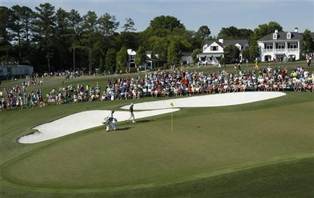 Louis Oosthuizen of South Africa walks onto the ninth green during final round play in the 2012 Masters Golf Tournament at the Augusta National Golf Club in Augusta, Georgia, April 8, 2012. REUTERS/Mike Segar