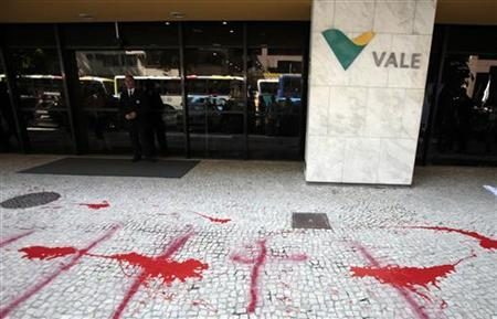 The entrance of the building of Brazilian mining company Vale is seen painted in red after a protest in Rio de Janeiro April 18, 2012. REUTERS/Sergio Moraes
