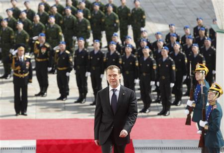 Russia's current President Medvedev walks to attend a ceremony to inaugurate Vladimir Putin as new President at the Kremlin in Moscow. REUTERS/Mikhail Klimentyev/RIA Novosti/Kremlin