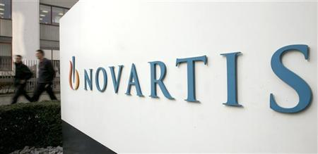 People walk past the logo of Swiss drugmaker Novartis at the company's plant in Basel January 28, 2009. REUTERS/Arnd Wiegmann