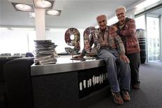 Ottavio Missoni, 91, poses with his wife Rosita, 81, at their company headquarters in Sumirago, northern Italy April 24, 2012. Missoni ran in the 1948 Olympics in London, where he met Rosita, who was studying English there. The two fell in love and later returned to Italy to found what was to become the Missoni fashion empire. Picture taken April 24, 2012. REUTERS/Alessandro Bianchi