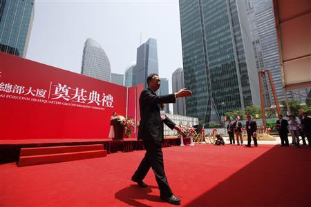 Taiwanese tycoon Terry Gou, founder of Foxconn, attends a ground breaking ceremony at the new China headquarters building at the Lujiazui financial district of Pudong in Shanghai May 10, 2012. REUTERS/Aly Song