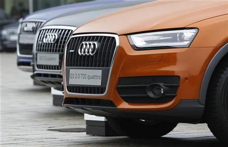 An Audi Q3 2.0 TDI quattro is parked outside of the company's annual news conference in Ingolstadt March 1, 2012. REUTERS/Michaela Rehle
