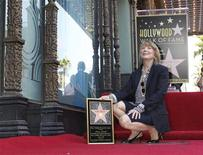Actress Sissy Spacek kneels atop her newly unveiled star on the Hollywood Walk of Fame in Hollywood August 1, 2011. REUTERS/Fred Prouser