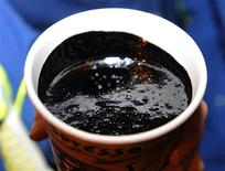 A cup of heavy oil produced at the Statoil oil sands operation near Conklin, Alberta, is seen in this file picture taken November 3, 2011. REUTERS/Todd Korol/Files