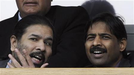 Blackburn Rover's joint owner Balaji Rao (L) and Venkatesh Rao of Venky's Ltd react ahead of their English Premier League soccer match against Arsenal in Blackburn, northern England in this September 17, 2011 file photo. REUTERS/Nigel Roddis/Files