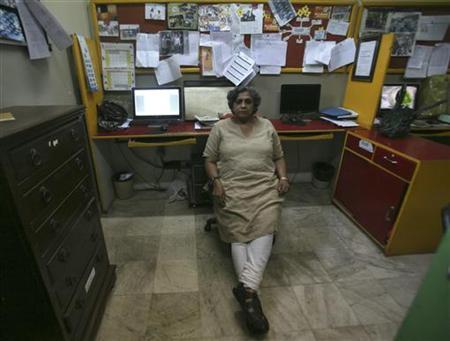 Anjali Gopalan, a gay rights activist, poses for a picture inside her office in New Delhi May 3, 2012. Legalising homosexuality has had little impact in conservative India as homophobia remains deeply entrenched, with thousands of gays across the country still facing discrimination and a lack of basic rights, Gopalan told Reuters. REUTERS/Parivartan Sharma