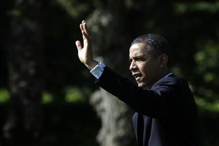U.S. President Barack Obama waves as he walks out from the Oval Office of the White House in Washington May 10, 2012, before his departure to attend campaign events in Seattle and Los Angeles. REUTERS/Yuri Gripas