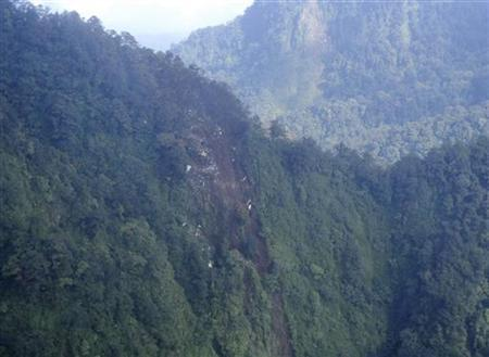 A view of the wreckage of the Russian Sukhoi Superjet 100 aircraft in Mount Salak, West Java province, as seen from an Indonesia Airforce Super Puma helicopter May 10, 2012. REUTERS/Handout/ Indonesian Air Force/Super Puma Helicopter/Major Levi
