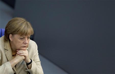 German Chancellor Angela Merkel attends a debate after delivering a statement on her government policies ahead of the upcoming G8 and NATO summits in the German lower house of parliament, the Bundestag, in Berlin, May 10, 2012. REUTERS/Thomas Peter