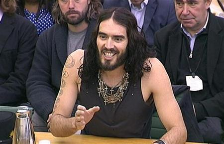 Comedian and actor Russell Brand is seen addressing the House of Commons Home Affairs Committee in a still image taken from video in central London April 24, 2012. REUTERS/Parbul TV via Reuters TV