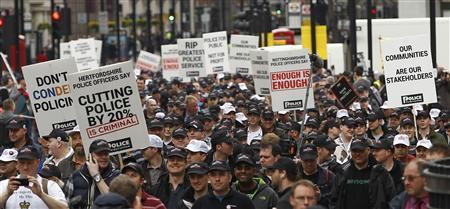 Off-duty police officers march in protest at funding cuts through central London May 10, 2012. REUTERS/Eddie Keogh