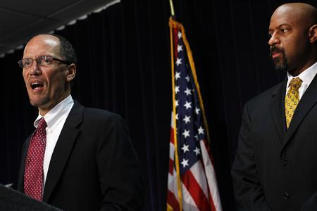 Department of Justice Assistant Attorney General Roy Austin (R) listens as Attorney General for Civil Rights Division of the Department of Justice Thomas Perez speaks during a news conference in Phoenix, Arizona May 10, 2012. REUTERS/Joshua Lott