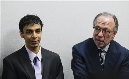 Dharun Ravi (L), a former Rutgers University student charged with bias intimidation, sits with lead defense attorney Steven Altman while awaiting a verdict in his trial at the Superior Court of New Jersey in Middlesex County, New Brunswick, New Jersey March 16, 2012. REUTERS/Lucas Jackson