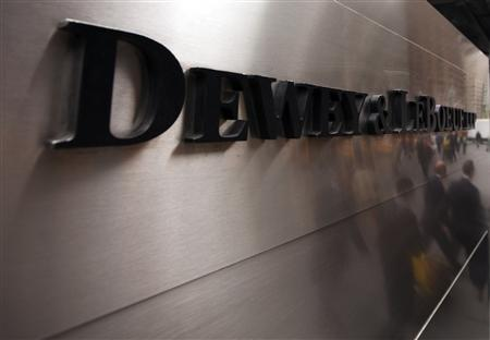 Pedestrians walk past a sign outside of the building housing the law firm Dewey & LeBoeuf LLP in New York, May 8, 2012. REUTERS/Lucas Jackson