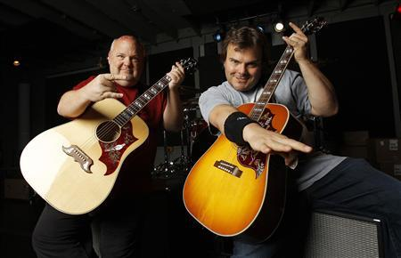 Jack Black (R) and Kyle Gass of Tenacious D pose for a portrait at Mates Studio in North Hollywood, California May 3, 2012. REUTERS/Mario Anzuoni