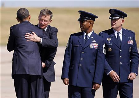 U.S. President Barack Obama (L) hugs Colorado Governor John Hickenlooper as he arrives at Buckley Air Force Base near Denver, September 27, 2011. REUTERS/Jason Reed