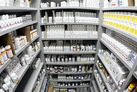 Pills line the shelves in the pharmacy at Venice Family Clinic in Los Angeles April 16, 2007. REUTERS/Lucy Nicholson/Files