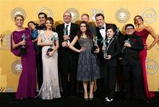 "The cast of ""Modern Family"" pose backstage after the show won outstanding performance by an ensemble in a comedy series at the 18th annual Screen Actors Guild Awards in Los Angeles, California January 29, 2012. REUTERS/Mike Blake"