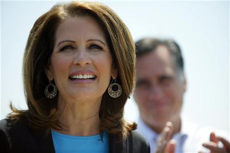 Congressman Michele Bachmann speaks next to U.S. Republican presidential candidate and former Massachusetts Governor Mitt Romney during a rally at Crofton Industries in Portsmouth, in this Virginia May 3, 2012 file photo. REUTERS/Mark Makela