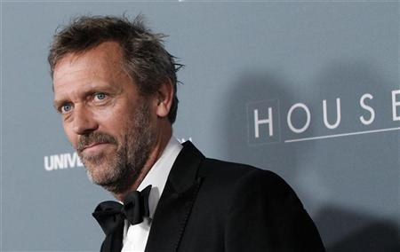 Cast member Hugh Laurie poses as he arrives at the series finale wrap party of the television series ''House M.D.'' in Los Angeles, California April 20, 2012. REUTERS/Mario Anzuoni
