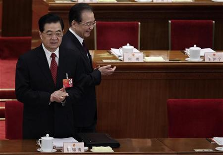 China's Premier Wen Jiabao (R) walks past President Hu Jintao as he arrives for the opening ceremony of the National People's Congress (NPC) at the Great Hall of the People in Beijing in this March 5, 2012 file photo. REUTERS/Jason Lee (CHINA - Tags: POLITICS BUSINESS)
