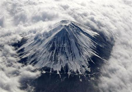 Japan's Mount Fuji, covered with snow and surrounded by cloud, is seen from an airplane February 2, 2010. REUTERS/Toru Hanai