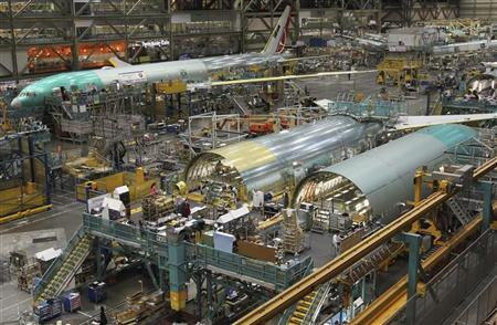 A Boeing 777 jetliner being manufactured for customer Turkish Airlines is seen in the background, near the fuselage of two other 777s (front), on the production line at Boeing's Commercial Airplane manufacturing facility in Everett, Washington February 14, 2011. REUTERS/Anthony Bolante