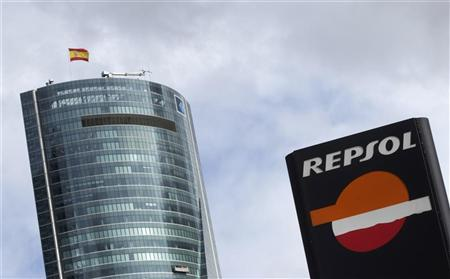 A Repsol logo is seen in front of Torre Espacio building in Madrid April 13, 2012. REUTERS/Susana Vera