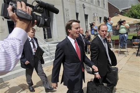 John Edwards exits a federal courthouse next to one of his defense lawyers, Abbe Lowell (R) in Greensboro, North Carolina May 10, 2012. REUTERS/Ted Richardson