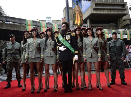 Actor Sacha Baron Cohen, playing Admiral General Aladeen, poses for photographers with models at the world premiere of the Dictator at the Royal Festival Hall in London May 10, 2012. REUTERS/Dylan Martinez