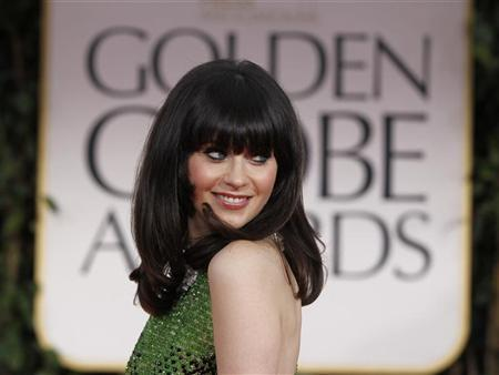 Actress Zooey Deschanel arrives at the 69th annual Golden Globe Awards in Beverly Hills, California January 15, 2012. REUTERS/Danny Moloshok