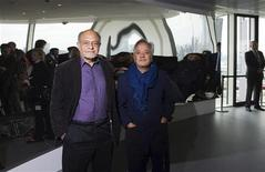 The designers of the ArcelorMittal Orbit, Cecil Balmond (L) and Anish Kapoor, pose for photographs at the top of the ArcelorMittal Orbit in the London 2012 Olympic Park in east London May 11, 2012. REUTERS/ Ki Price