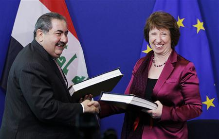 European Union Foreign Policy Chief Catherine Ashton shakes hands with Iraqi Foreign Minister Hoshyar Zebari (L) after signing a cooperation agreement at the EU Commission headquarters in Brussels May 11, 2012. REUTERS/Francois Lenoir