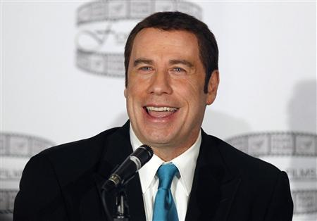 Actor John Travolta speaks during a news conference to promote the film ''Gotti:Three Generations'' in New York in this file photo taken April 12, 2011. REUTERS/Brendan McDermid/Files