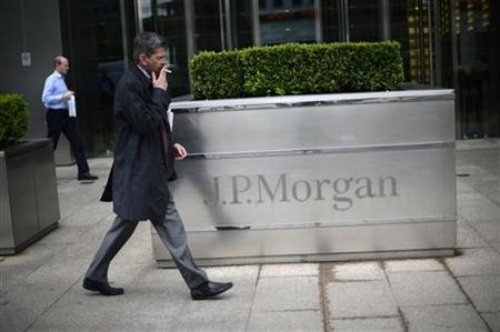 A man walks past the JP Morgan headquarters at Canary Wharf in London May 11, 2012. REUTERS/Dylan Martinez