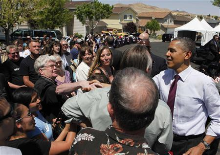 U.S. President Barack Obama shakes hands with residents following a speech after meeting with homeowners Val and Paul Keller to discuss the housing crisis in Nevada, at their Clear Acre neighborhood home in Reno, Nevada, May 11, 2012. REUTERS/Larry Downing