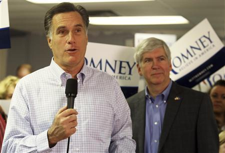 Michigan Republican Governor Rick Snyder (R) listens as U.S. Republican presidential candidate Mitt Romney (L) addresses the media during a stop at Romney's Michigan campaign headquarters in Livonia, in this February 28, 2012 file photo. REUTERS/Rebecca Cook/Files