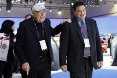 Automotive designer and race car driver Carroll Shelby (L) walks to his seat at the Ford press conference at the LA Auto Show in Los Angeles November 16, 2011. REUTERS/Danny Moloshok