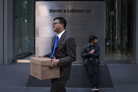 A man walks out of the Dewey & LeBoeuf offices with a box in New York May 11, 2012. REUTERS/Eduardo Munoz