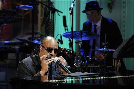 Stevie Wonder plays the harmonica as he performs the song Alfie during a concert in the East Room of the White House, May 9, 2012. REUTERS/Jonathan Ernst