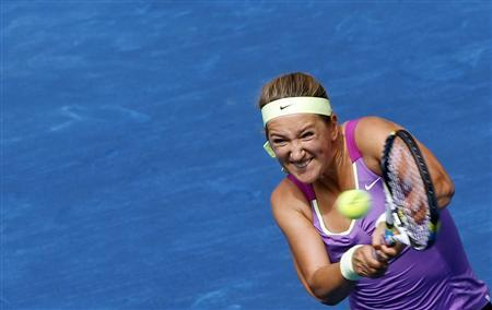 Victoria Azarenka of Belarus returns the ball to Agnieszka Radwanska of Poland during their women's semi-final singles match at the Madrid Open tennis tournament May 12, 2012. REUTERS/Susana Vera