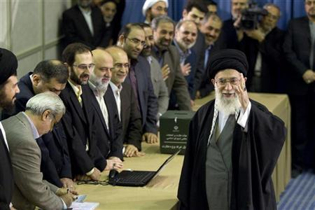 EDITORS' NOTE: Reuters and other foreign media are subject to Iranian restrictions on leaving the office to report, film or take pictures in Tehran. Iran's Supreme Leader Ayatollah Ali Khamenei waves to the media after presenting his identification papers to cast his ballot in the parliamentary election in Tehran March 2, 2012. REUTERS/Caren Firouz