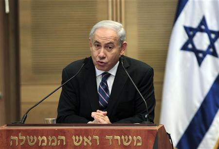Israel's Prime Minister Benjamin Netanyahu (L) speaks during a joint news conference with Shaul Mofaz (not seen), head of the Kadima party which join Netanyahu's rightist coalition, at parliament in Jerusalem May 8, 2012. REUTERS/Ammar Awad