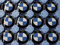 BMW luxury car logo's are pictured next to the production line of the German car manufacturer's plant in the Bavarian city of Dingolfing March 6, 2012. REUTERS/Michaela Rehle