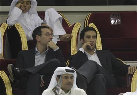 Schalke 04's Raul (R) of Spain watches the Emir Cup final match between Al-Sadd and Al-Gharafa at Khalifa stadium in Doha May 12, 2012. REUTERS/Fadi Al-Assaad