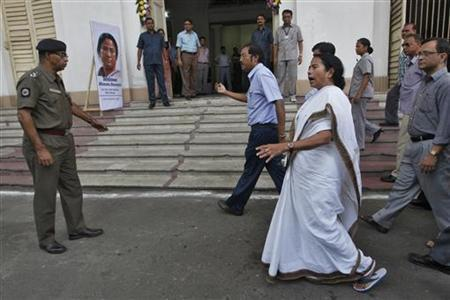 Mamata Banerjee (in white), chief minister of West Bengal, arrives to attend a convention with the state's civil service officers in Kolkata April 21, 2012. REUTERS/Rupak De Chowdhuri